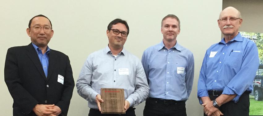 Kawasaki Motors grants a Service Award to its supplier Roski Composites